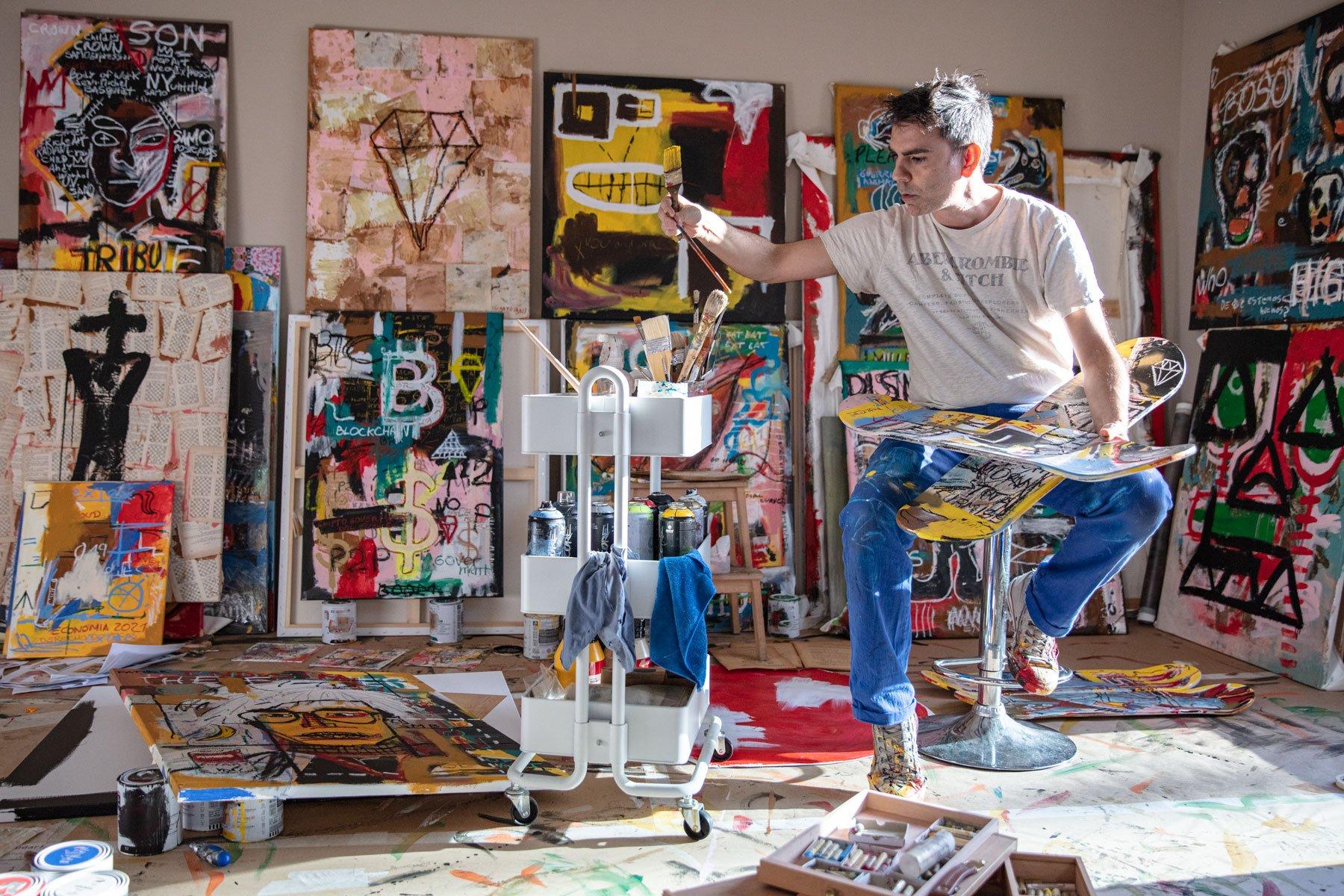 Diego Tirigall, Street Artist panting on skate board decks